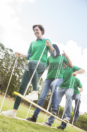 teammates doing trolley team building exercise
