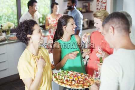 woman serving friends at party