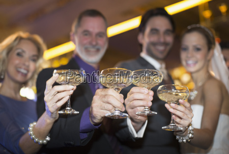 portrait of bride and groom toasting