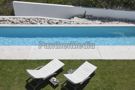 lounge chairs by modern lap pool