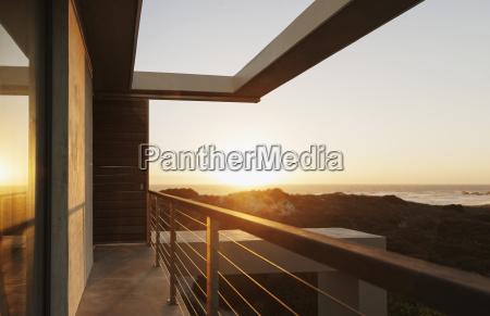 balcony of modern house overlooking ocean