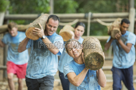 determined people running with logs on