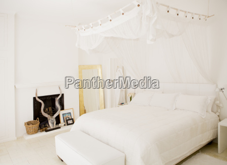 canopy over bed in modern bedroom