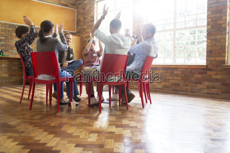 people clapping in group therapy session
