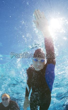triathlete in wetsuit underwater