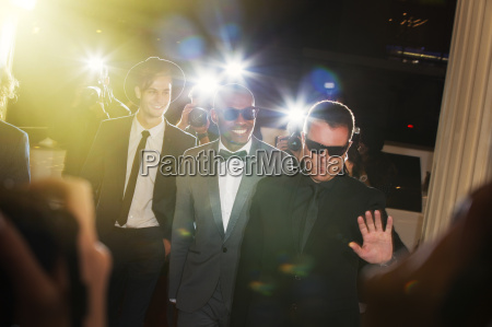 bodyguard escorting celebrities arriving at event