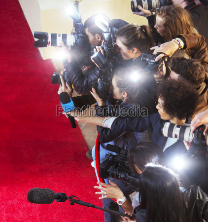 paparazzi photographers photographing at red carpet