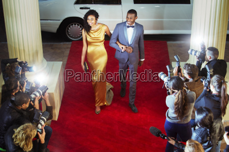 celebrity couple arriving at red carpet