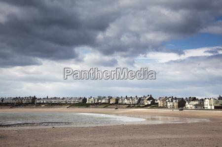 clouds forming over coastal village