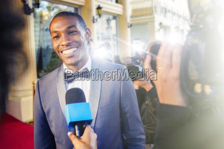 celebrity being interviewed and photographed by