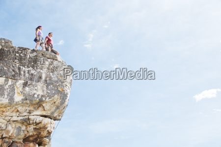 climbers standing on rocky hilltop