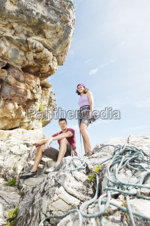 climbers with rope on rock formation