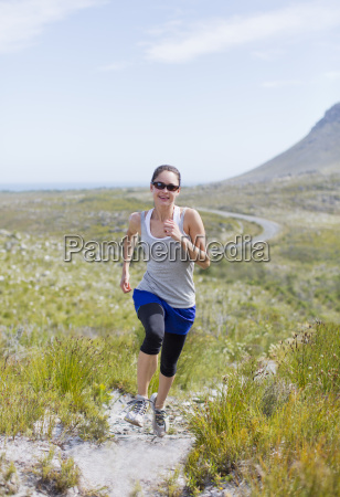woman running on dirt path