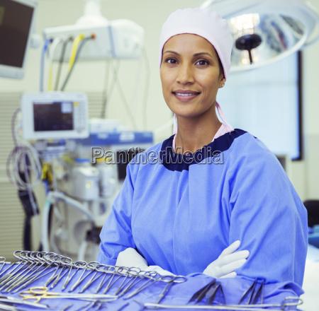 portrait of confident surgeon near surgical
