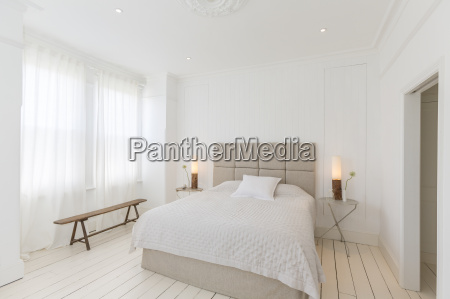 bed and tables in modern bedroom