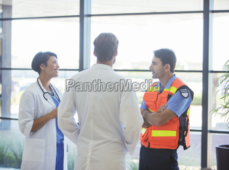 doctors and paramedic talking in hospital