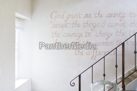quote on wall of rustic house