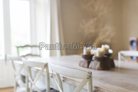 candles on dining table of rustic