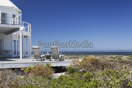 lounge chairs on deck overlooking ocean