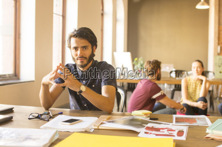 portrait confident creative businessman working with