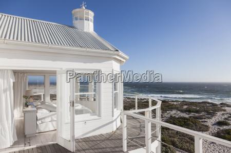 white bedroom overlooking ocean