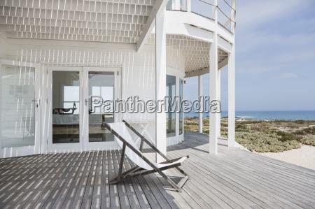 deck chair on deck overlooking beach