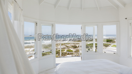 white bedroom overlooking ocean