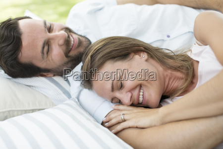 couple relaxing on blanket outdoors