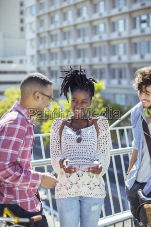 friends talking on city street