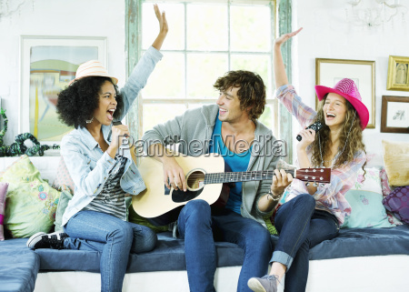 friends singing and playing music together