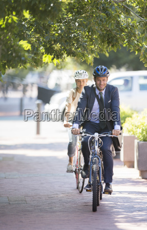 businessman in suit and helmet riding
