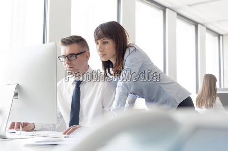 focused businessman and businesswoman working at