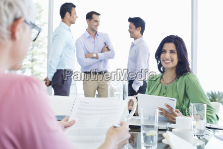 business women talking in meeting