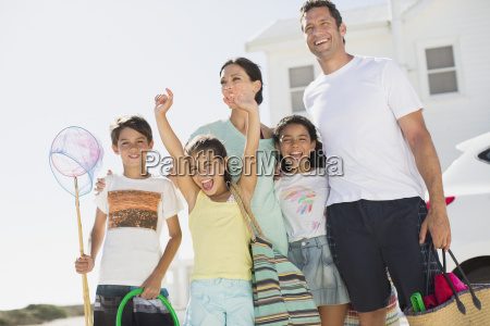 enthusiastic family with beach gear