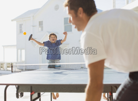father and son playing table tennis