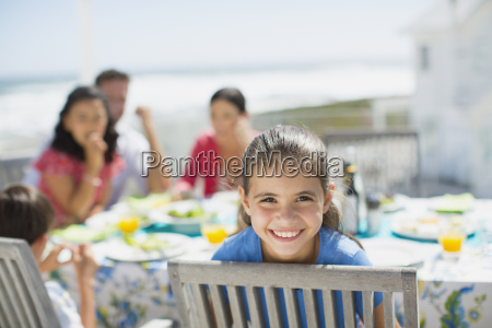 smiling girl at table on sunny