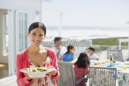 woman holding salad bowl on sunny