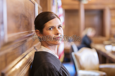 judge standing in courtroom