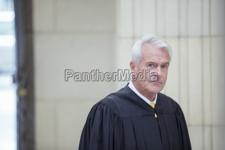 judge standing in courthouse
