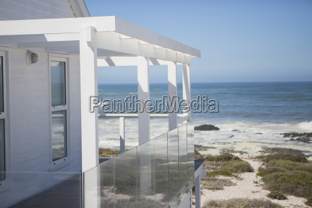 beach house and balcony overlooking ocean