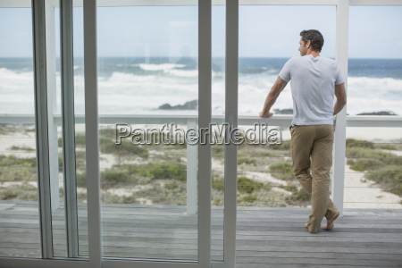 man looking at ocean view from