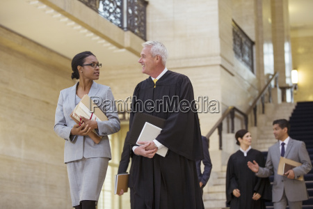 judge and lawyer walking through courthouse