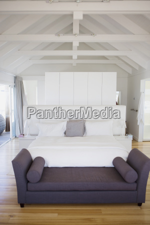 sofa and bed in modern bedroom