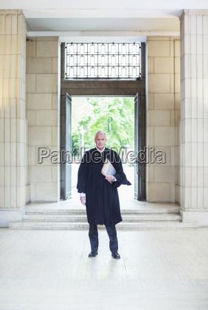 judge standing in front of doors