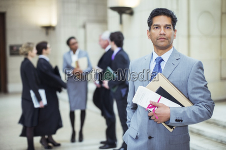 lawyer holding legal documents in courthouse
