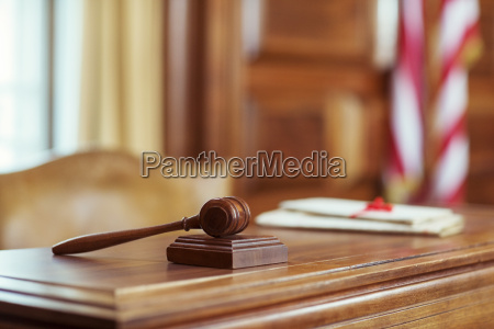 gavel laying on judges bench in