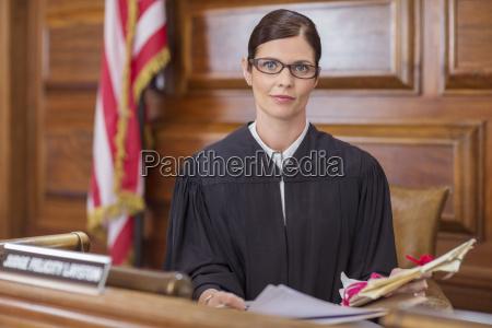 judge examining documents at judges bench