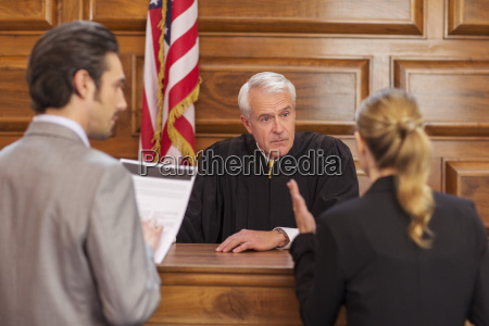 lawyers pleading case to judge in