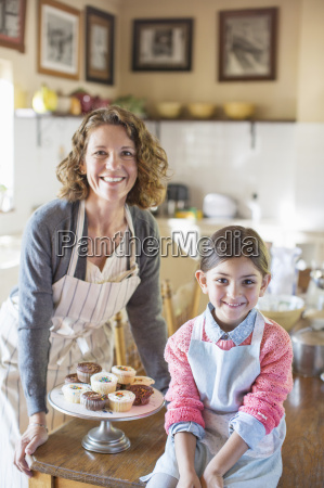 grandmother and granddaughter smiling in kitchen
