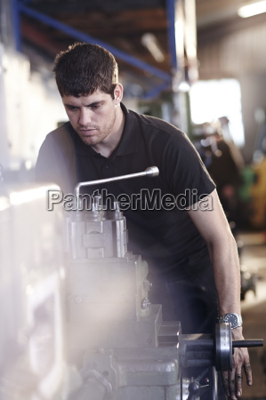 mechanic working at machinery in auto